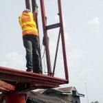 Zeepad construction team constructing a billboard